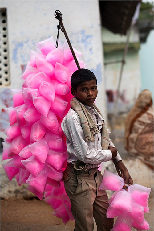 Indian boy sells cotton candy by Alon Messika